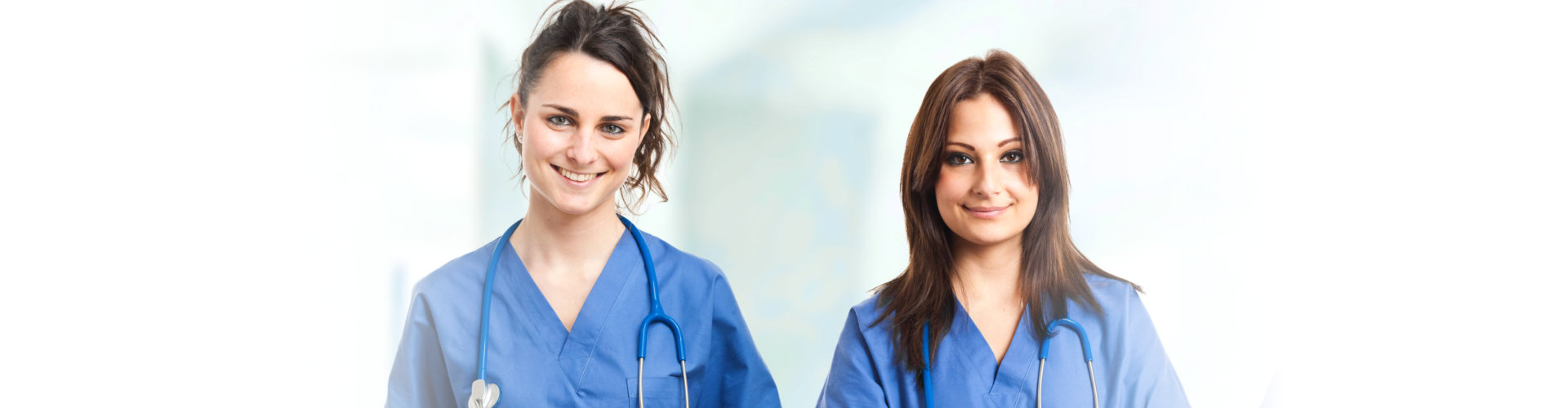 2 nurses facing the camera