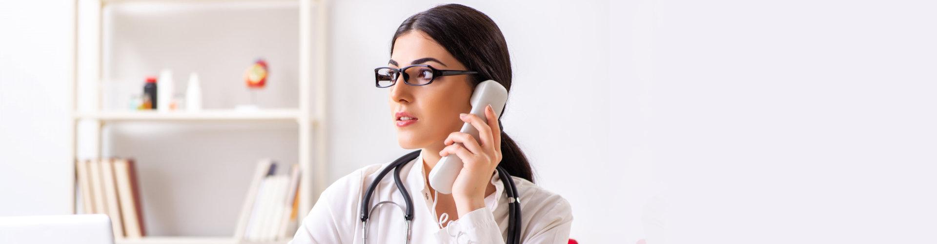 female doctor taking call